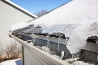 Ice damming and melting snow on a Louisville home.