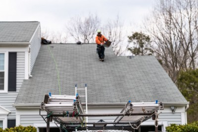 An expert preforming a roof inspection in Louisville.