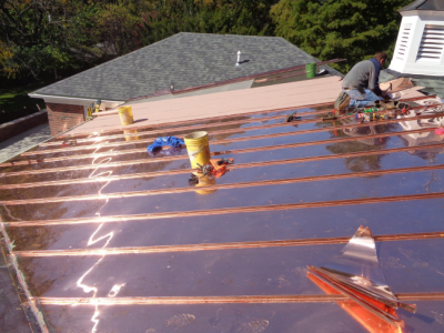 Installing copper roofing on a home in Louisville, KY.
