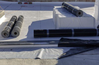 Materials ready for a TPO roof installation job in Louisville, KY.
