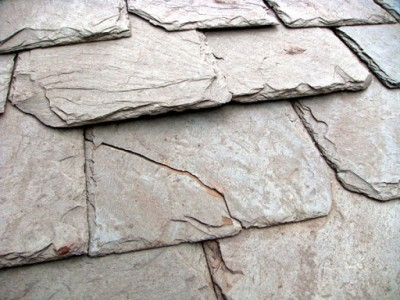 When stepped on, real slate roof tiles can crack and break.